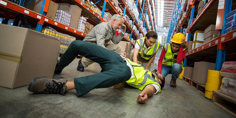 man on ground injured at work